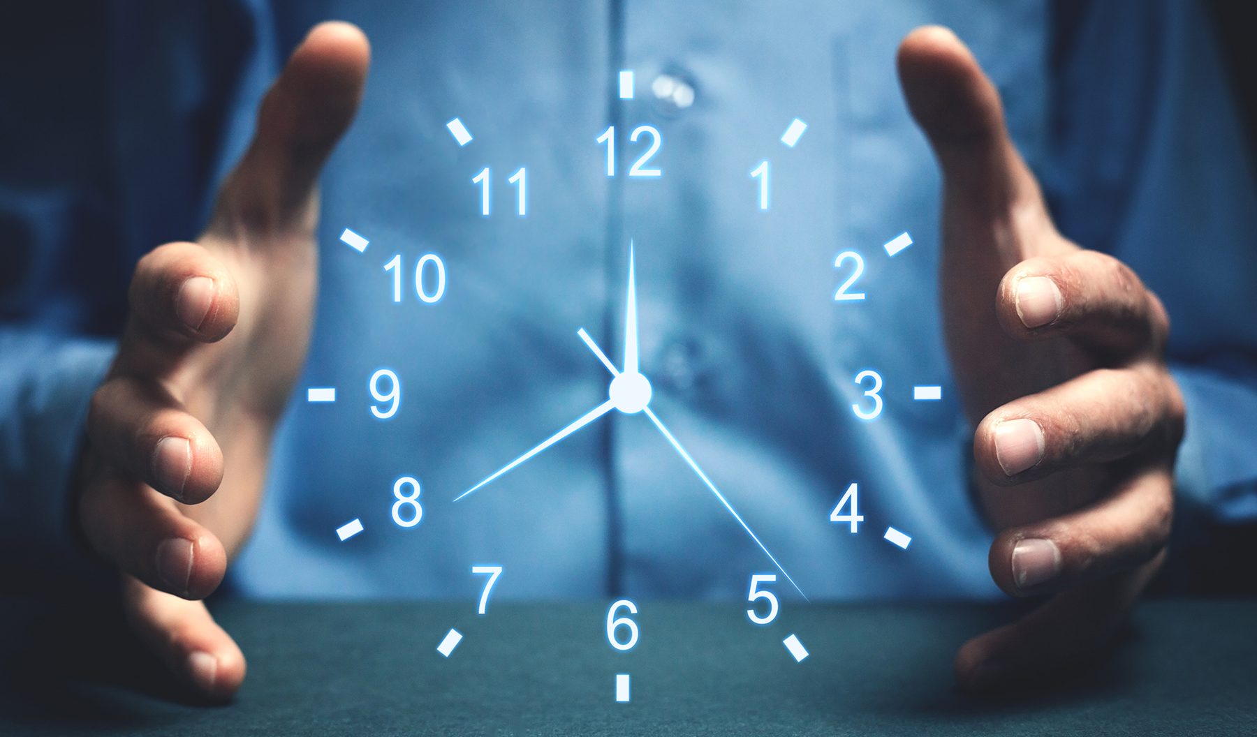 hands holding clock, time management